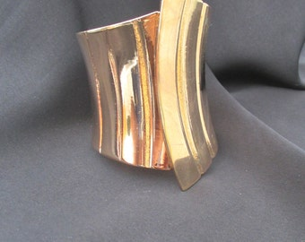 Vintage rose gold tone metal clamper style cuff
