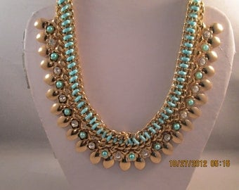 4 Row Gold Tone Chain Choker Necklace with Gold Tone Charms, Turquoise Ribbon and Beads and Clear Rhinestones