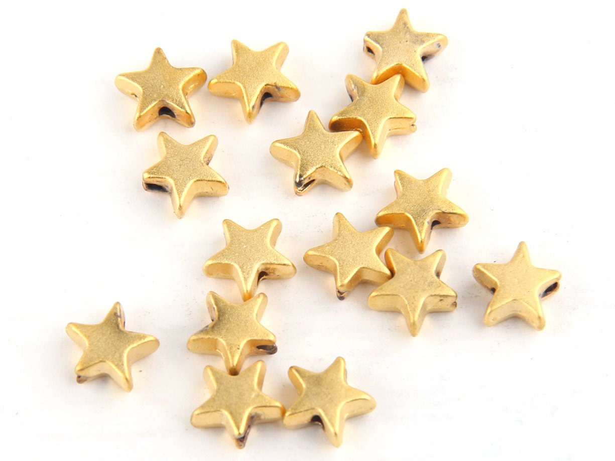 Mini gold star bead spacers k matte plated pieces