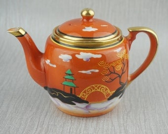 Small Noritake Ceramic Teapot with Lid Orange Oriental Scene with Gold Trim