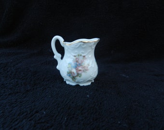 Doll house toy pitcher