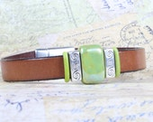 Woman's brown leather bracelet, Iridescent apple green porcelain bead, Magnetic clasp, CarolMade L49