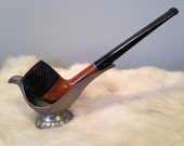 AC - This is a vintage Medico Double-Dri tobacco pipe