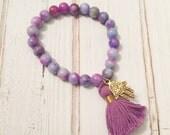 Multi color pink and purple jade beaded bracelet with purple tassel and gold plated hamsa