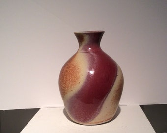 Bulbous form dark red, rust, brown and off-white swirl glazed vase