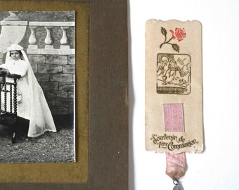 cute old religious card with pink ribbon and medal dated 1924