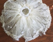 Lace tutu with lace ruffle edges and flower accents