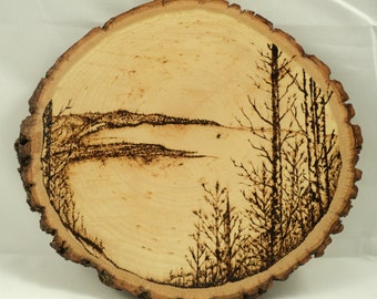 Rustic Woodburned Tree Slice Lake Landscape Design