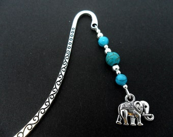 A tibetan silver elephant and turquoise  bead bookmark.