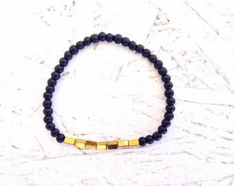 Black glass bead bracelet with gold hematite cube focal beads