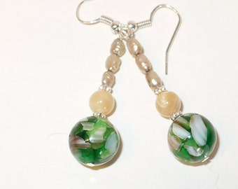 Picasso green glass bead with natural mother of pearl and natural seed pearl earrings.