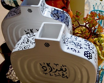 Two white ceramic vase. With arabic calligraphy poetry نزار قباني، موال بغدادي