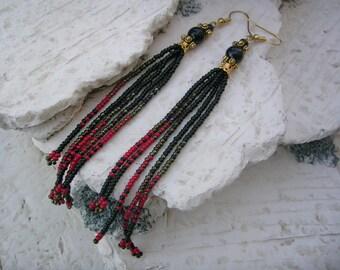 Black and red beaded tassel earrings.