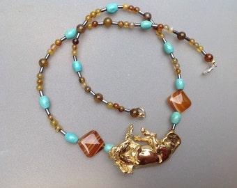 Rolling horse pendant bead necklace.  All gemstones.  Zimmer original jewelry
