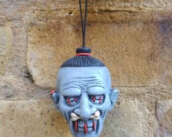 Grey Shrunken Head Ceramic Dangler Dead Head Danglers tsantsa