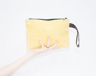 yellow clutch bag made with waxed canvas and genuine leather, organic cotton and sustainable beeswax