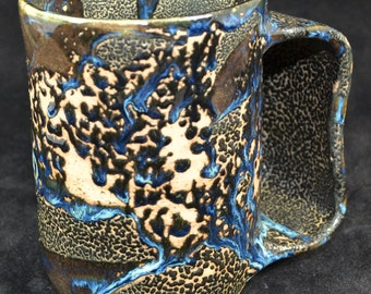 Tall black handwarmer mug