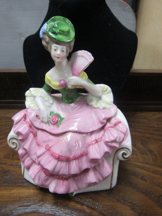 Figural lady vanity jar seated holding fan two piece
