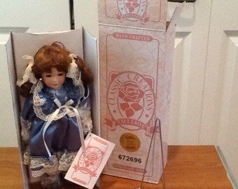 "Collectible ""Mitzi"" porcelain Doll"