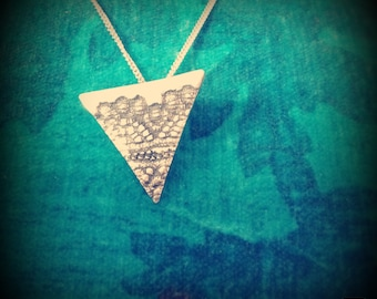 Triangle silver pendant with lace imprint