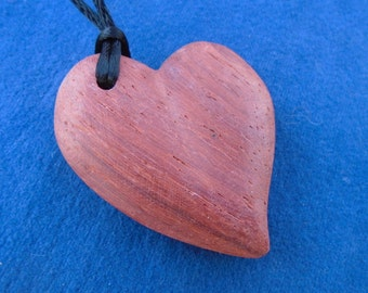 Carved wood heart pendant. Exotic wood amulet. Heart shaped necklace. Valentine's day gift.