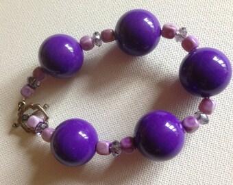 pretty plastic beaded bracelet purple beads
