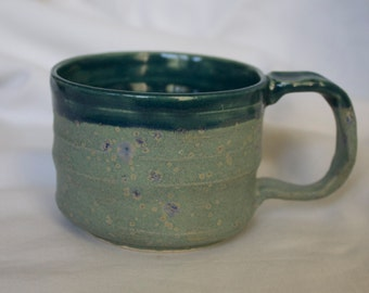 Small Mug in Robins Egg and Teal (a combination of matte light blue/green and dark blue/green) with a wavy accent