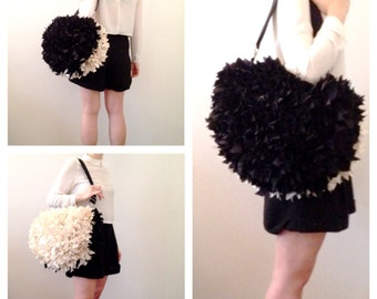 cream and black felt bag woven handles and shoulder strap