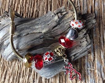 Browning deer buck in red rhinestones Valentine bracelet: charm bracelet with deer and arrow