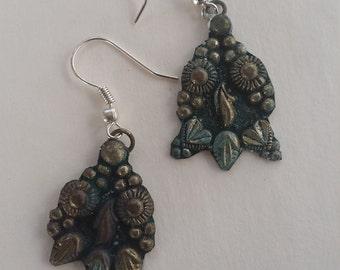 Upcycled rustic Thai metal ornate earrings on silvertone shepherd hooks