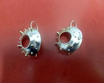 Silver earrings and copper skewers