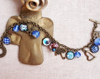 Dangling charms lampwork beads Blue theme cabochon playful bracelet