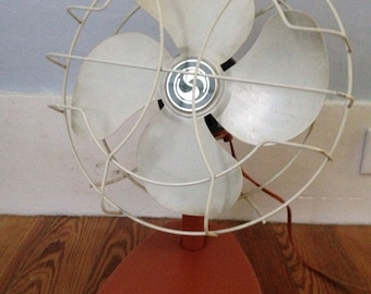 vintage superior electric fan with new orange paint. oscillates, works great!