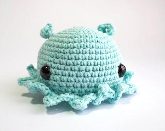 Adorabilis octopus pastel blue, amigurumi crocheted soft toy. Height 8cm/Width 12 cm