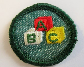 "Vintage Intermediate Girl Scout Badge ""Childcare"" circa 1950's"