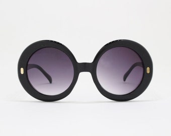 60s style sunglasses, round oversized glasses, black frame, black lens, women's eyewear