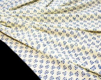 Cream Cotton fabric  hand block prined in blue with border