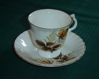 Bluebird China yellow rose cup and saucer VGU