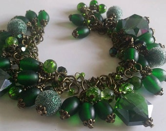 Exquisite Emerald  fully Loaded Charm Bracelet