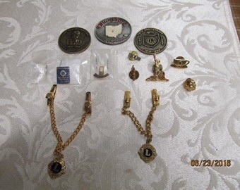 Vintage Assortment Lot of 12 Lions Club Pieces Coins Tokens Sweater Clip Tie Chain Clip Lapel Hat Pins