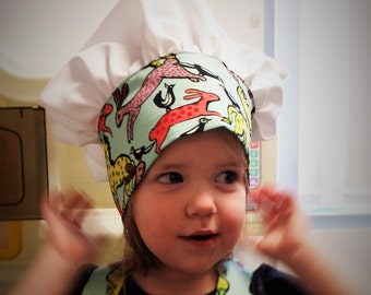 toque chef. small head. hats Cook for child.