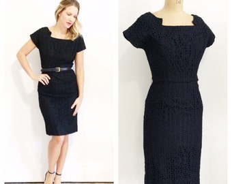 1950's black eyelet wiggle dress with cut out neckline. Size S/M.