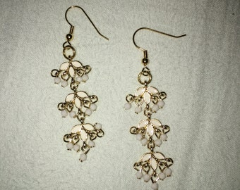 Gold and white dangly earrings