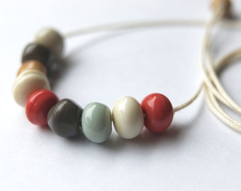 The Botticelli Collection- Lampwork beaded necklace - 9 beads on cotton cord- warm colours