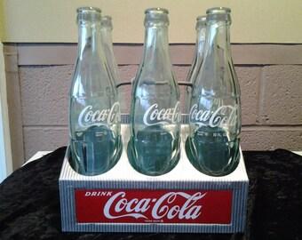 coke bottles in carrier