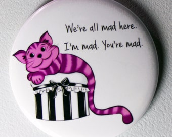We are All Mad Here....Cheshire Cat Pinback Button or Magnet