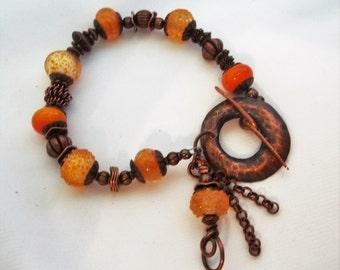 Orange lampwork and copper bracelet.  Orange and copper  Copper jewelry  copper bracele  Orange lampwork  Handmade copper  Lampwork bracelet