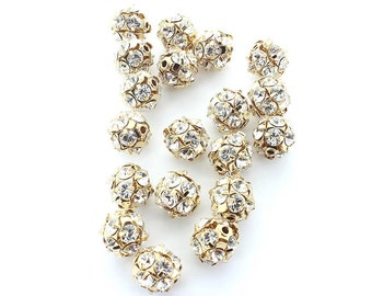 Swarovski 12mm gold plated rhinestone balls.  Price is for 4 pieces