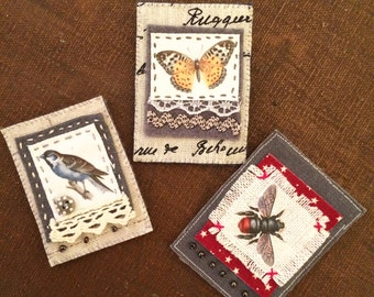 Hand stitched fabric brooches