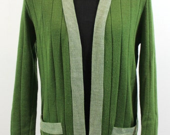 Olive green wool sweater with white striped band of trim on pockets, colllar and front panels. Open in the front